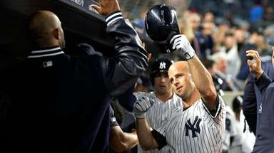 Brett Gardner of the Yankees celebrates his third