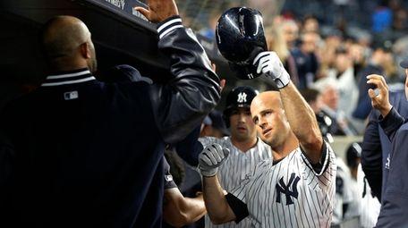 Brett Gardner of the Yankees celebrates his third