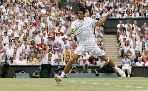 Serbia's Novak Djokovic returns a shot to Spain's
