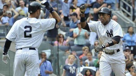 New York Yankees' Derek Jeter greets Curtis Granderson