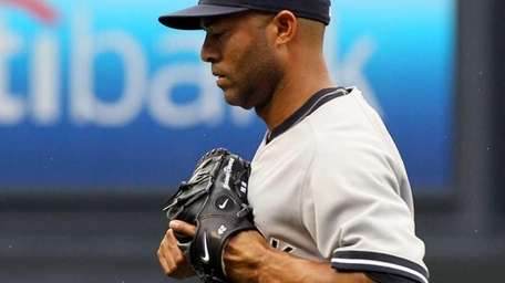 Mariano Rivera walks to the dugout after allowing