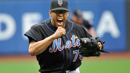 Francisco Rodriguez reacts after the final out in