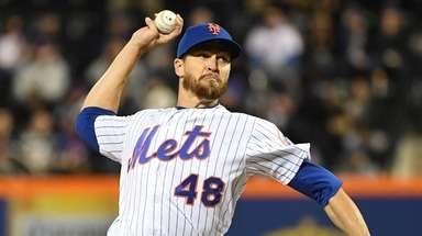 Mets starting pitcher Jacob deGrom delivers a pitch