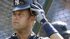 New York Yankees' Derek Jeter puts on his