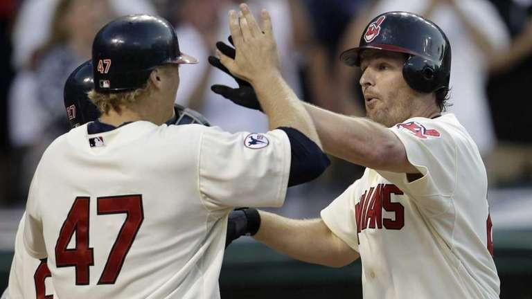 Cleveland Indians' Austin Kearns, right, is congratulated by