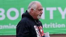 Long Island Ducks manager Wally Backman watches participants