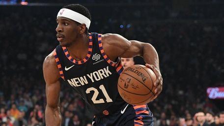 Knicks guard Damyean Dotson drives the ball against