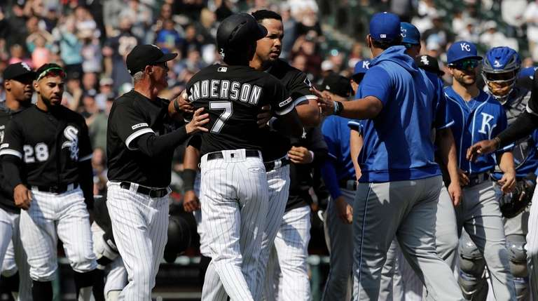 The White Sox's Tim Anderson is restrained by