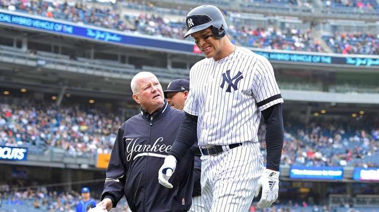 Aaron Judge of the Yankees is checked by