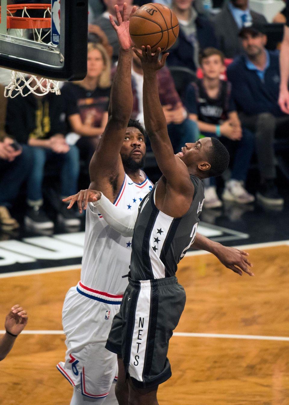 Nets guard Caris LeVert (22) drives on 76ers