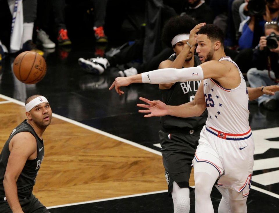 Nets center Jarrett Allen (31) defends as 76ers