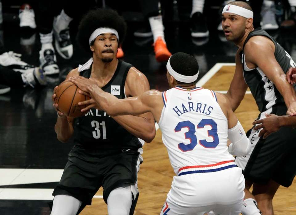 Nets center Jarrett Allen (31) gets the shot