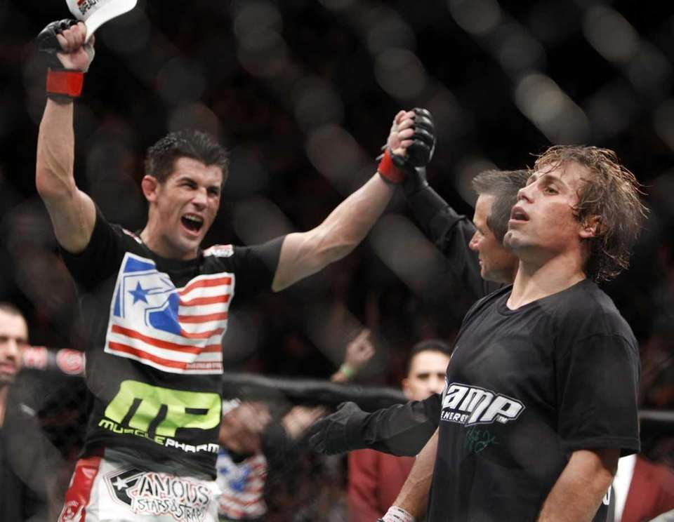 Dominick Cruz, left, celebrates his victory over Urijah