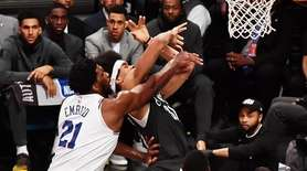 76ers center Joel Embiid (21) fouls Nets center
