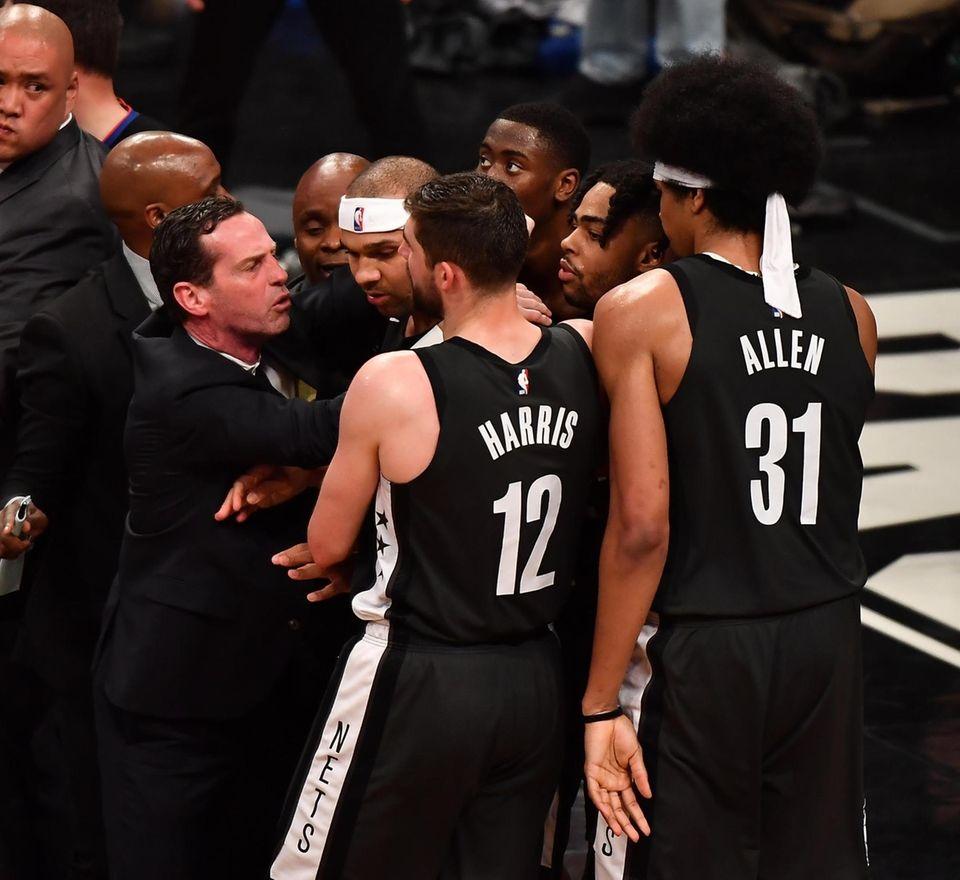 Nets head coach Kenny Atkinson grabs Nets forward