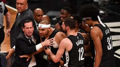 Nets head coach Kenny Atkinson grabs Nets forward