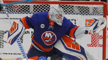 Islanders goaltender Robin Lehner make the glove save