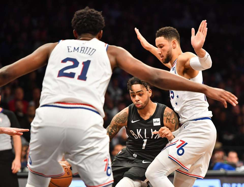 Nets guard D'Angelo Russell (1) is defended by