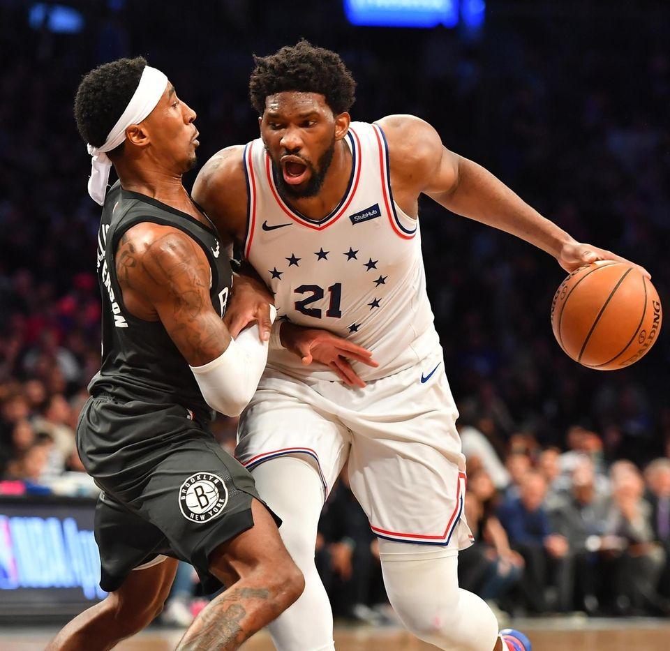 Nets forward Rondae Hollis-Jefferson defends 76ers center Joel