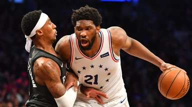 Nets forward Rondae Hollis-Jefferson defends 76ers center Joel