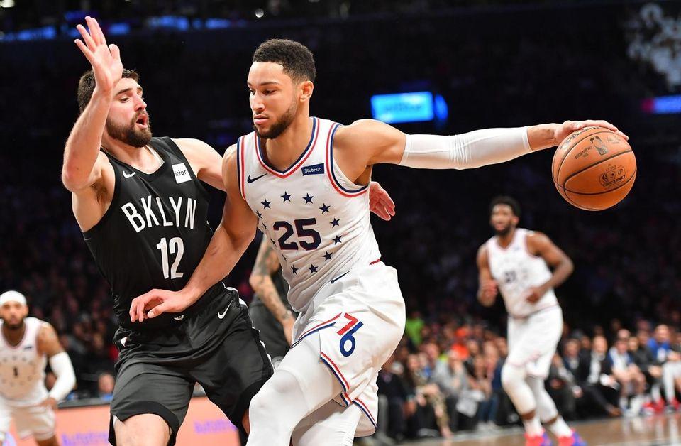 Nets forward Joe Harris (12) defends 76ers guard