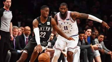 Nets guard Caris LeVert (22) drives on 76ers