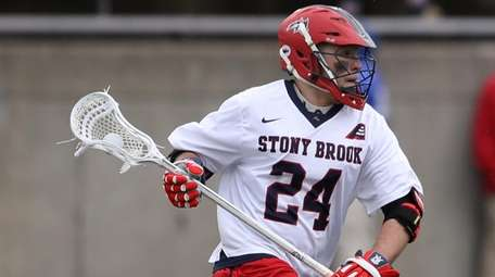 Stony Brook's Tom Dugan drives up field during