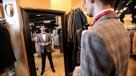 Keanu Waters tries on looks at Black Tie