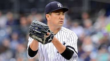 Masahiro Tanaka of the Yankees delivers the pitch