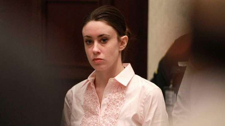Casey Anthony stands for the arrival of the