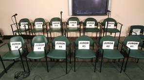 The empty juror chairs in the media room