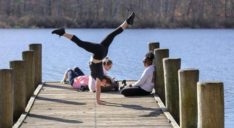 Ciara Bookman, of Hicksville, practices her hand stands