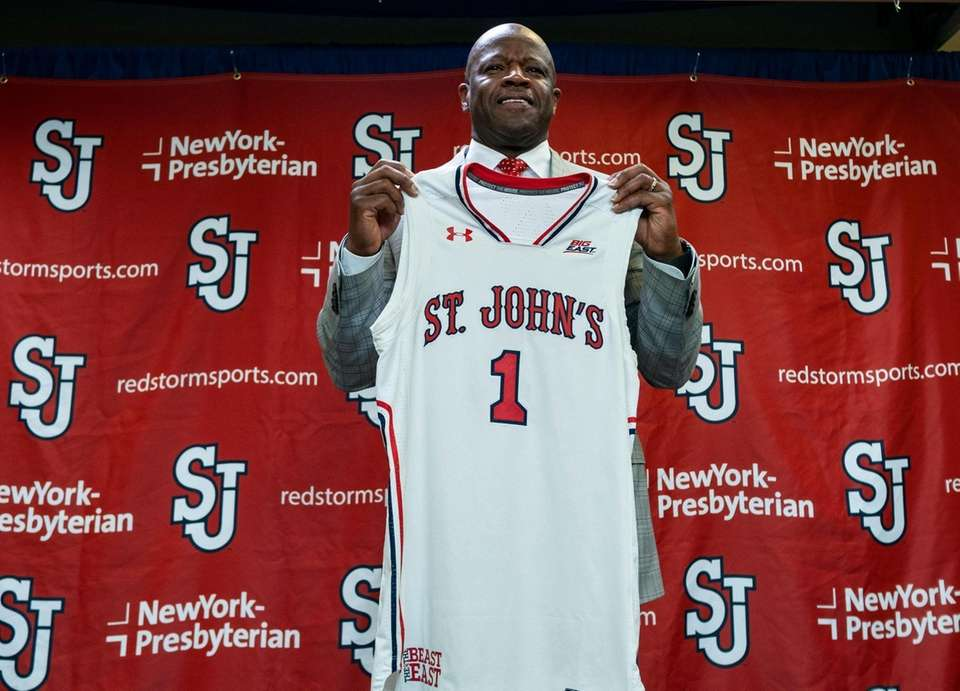 Mike Anderson holds a St. John's jersey after