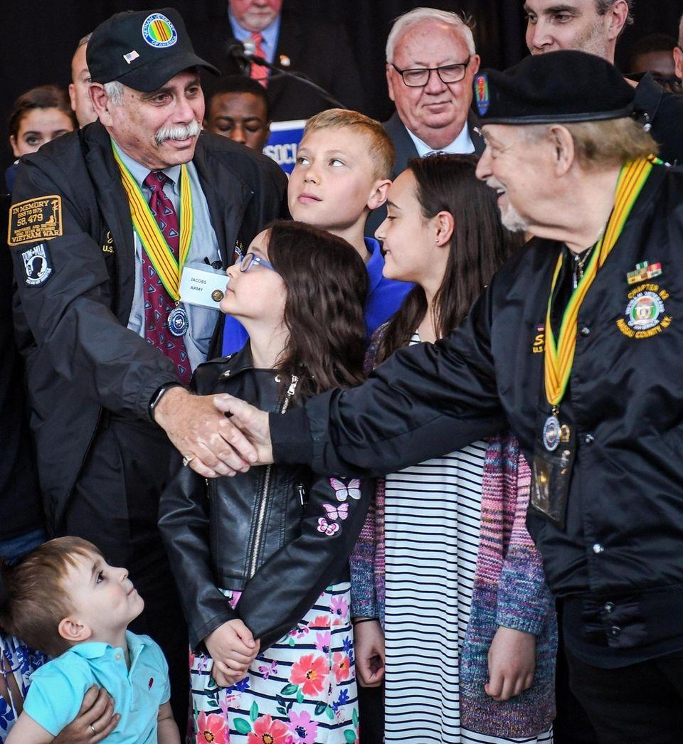 Army veteran Jeffrey Jacobs, of Syosset, shakes hands