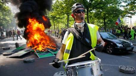A man bangs a drum during a yellow