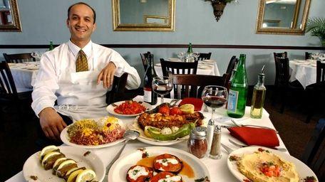 Saeid Sheiklar sits at Azerbaijan Grill in Westbury