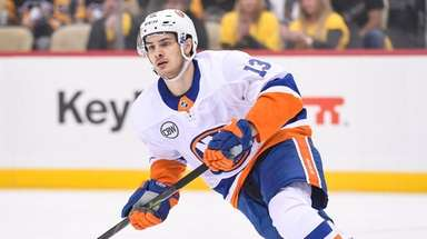 Islanders center Mathew Barzal (13) skates during the