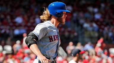 Mets' Noah Syndergaard, left, rounds the bases after