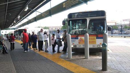 Customers board the N72 Long Island Bus to