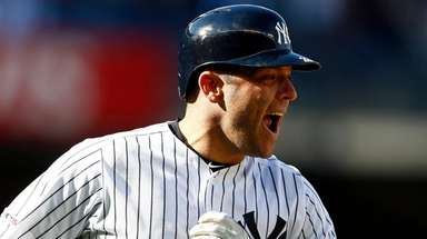 The Yankees' Austin Romine reacts after hitting a