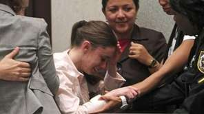 Casey Anthony, center, is overcome with emotion following