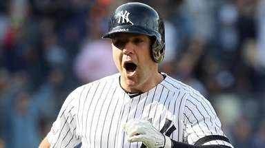 Austin Romine reacts after hitting a walk-off single