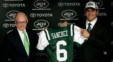 Jets owner Woddy Johnson, left, presents Mark Sanchez,