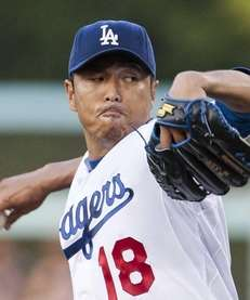 Los Angeles Dodgers starting pitcher Hiroki Kuroda throws