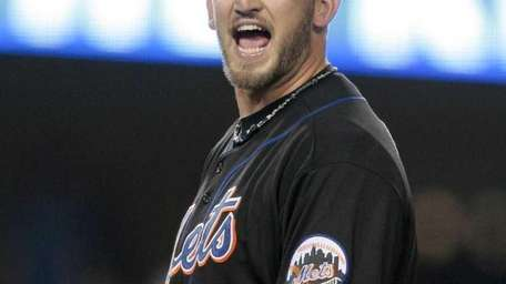 New York Mets starting pitcher Jonathon Niese argues