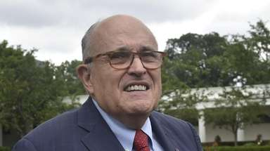 President Donald Trump's lawyer, Rudy Giuliani, walks outside