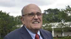 President Donald Trump's lawyer, Rudy Giuliani, walks outside