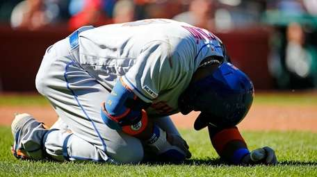 Robinson Cano #24 of the Mets reacts after
