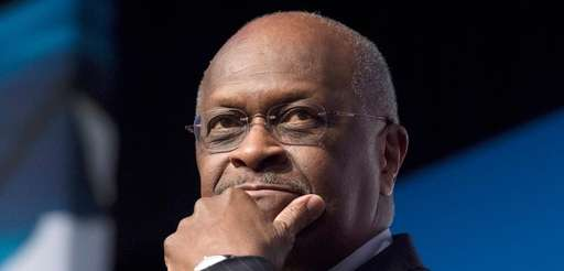 Herman Cain speaks during Faith and Freedom Coalition's