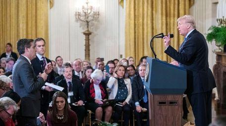 President Donald J. Trump speaks with CNN reporter
